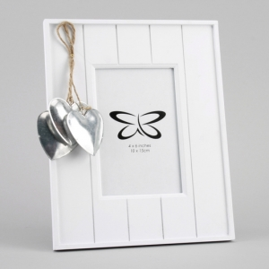 white frame with silver hearts
