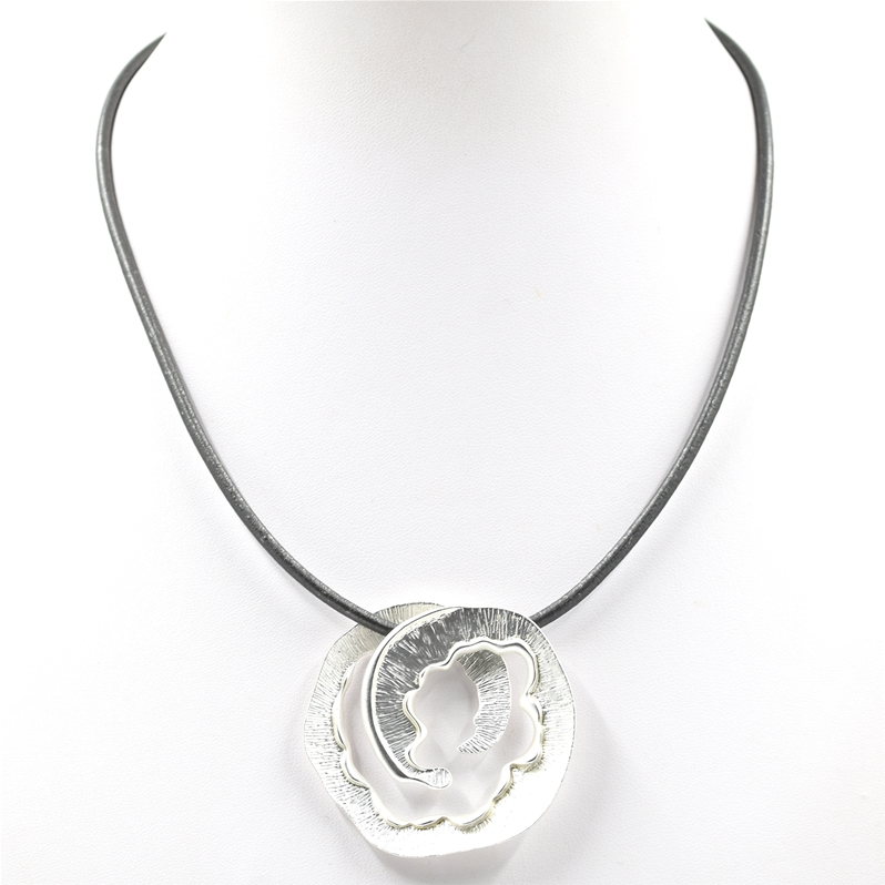 matt silver swirl necklace on grey leather