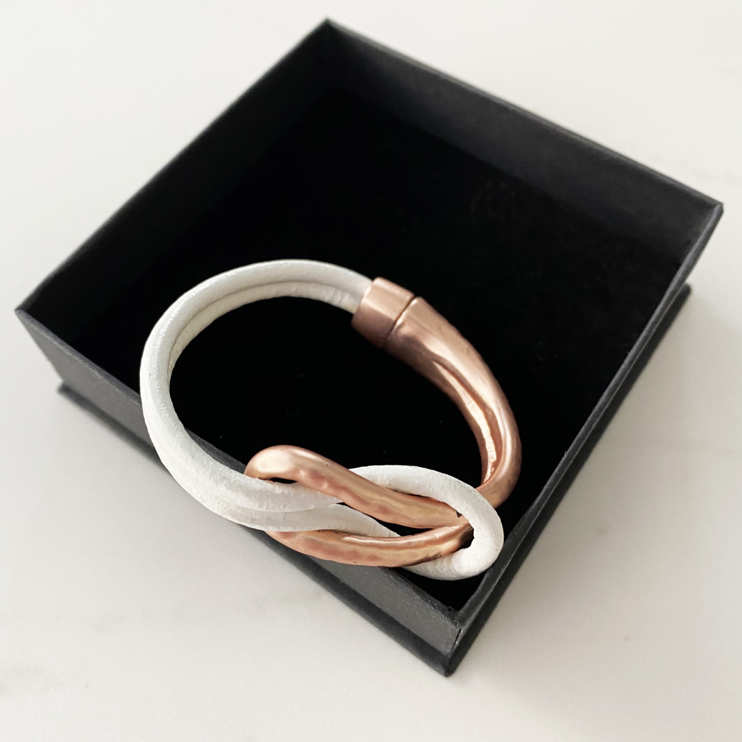 Rose gold and white leather knot bracelet