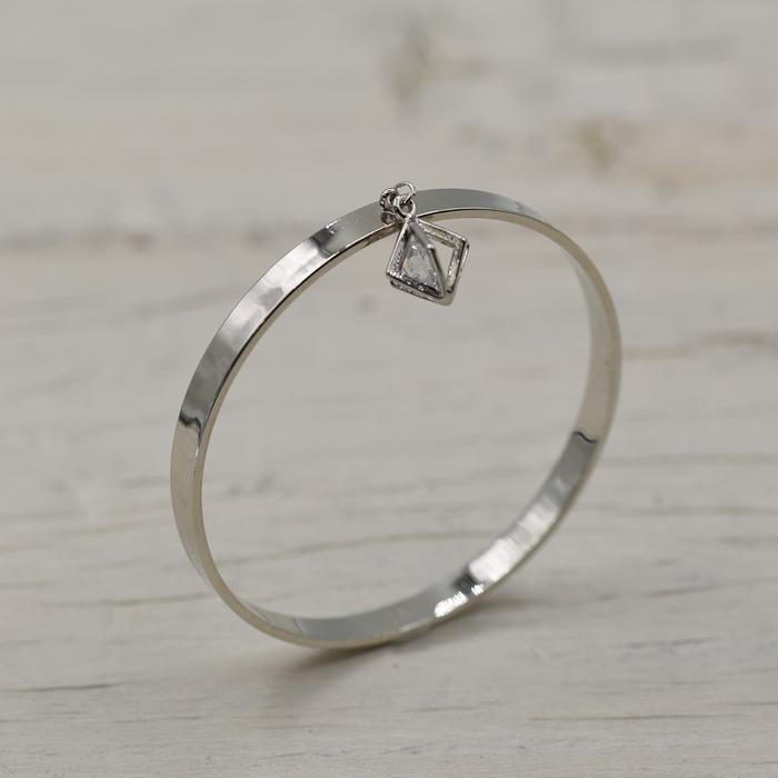 Silver bracelet with hanging crystal