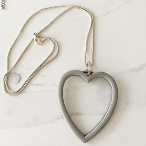 grey hollow heart necklace
