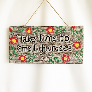 Take time to smell the Roses sign