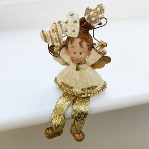 Shelf-sitting angel with hearts