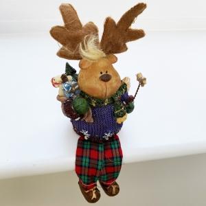 Shelf-sitting reindeer holding stars