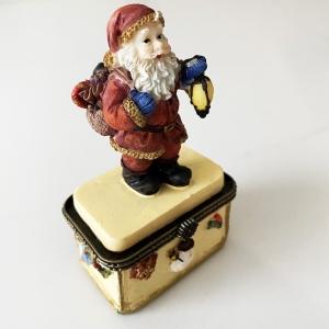 Small Santa on gift box